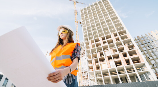 woman-studying-draft-construction-site
